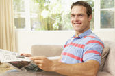 Man Reading Newspaper At Home — Stock Photo