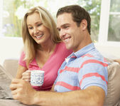 Couple Reading Newspaper At Home — Stock Photo