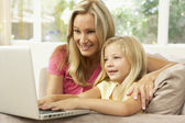 Mother And Daughter Using Laptop At Home — Stock Photo