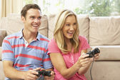 Young Couple Playing Computer Game On Sofa At Home — Foto Stock