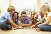 Family Playing Board Game At Home With Grandparents Watching — Foto Stock