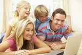 Family Using Laptop At Home Together — Stock Photo