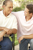 Senior Man Having Serious Conversation Adult Son — Stock Photo