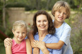 Grandmother With Grandchildren In Garden — Foto Stock