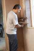 Plasterer Working On Interior Wall — Stockfoto
