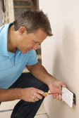 Electrician Installing Wall Socket — Stock Photo