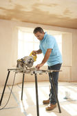 Builder Using Electric Saw — Stock Photo