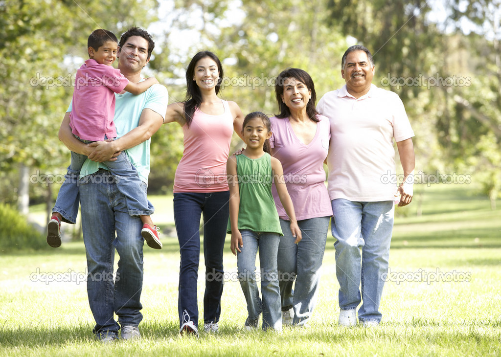 Extended Family Group Walking In Park — Stock Photo #4822372