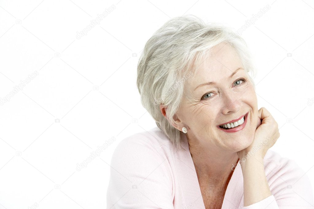 Studio Portrait Of Smiling Senior Woman — Stock Photo #4823715