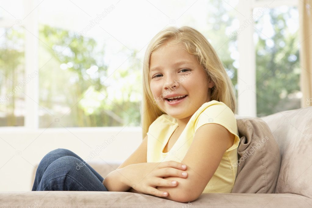 Young Girl Relaxing On Sofa At Home — Stock Photo #4823844