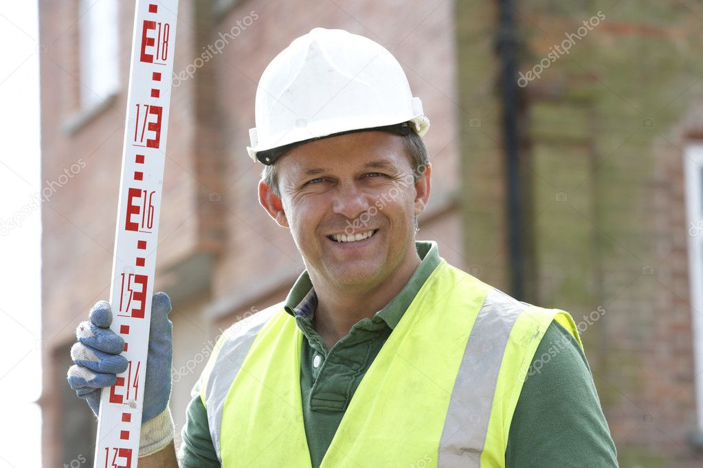 Construction Worker Holding Measure  Stock Photo #4824022