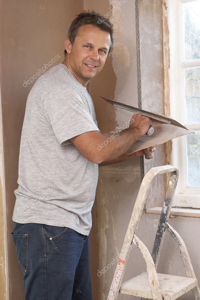 Plasterer Working On Interior Wall  Stock Photo #4824026