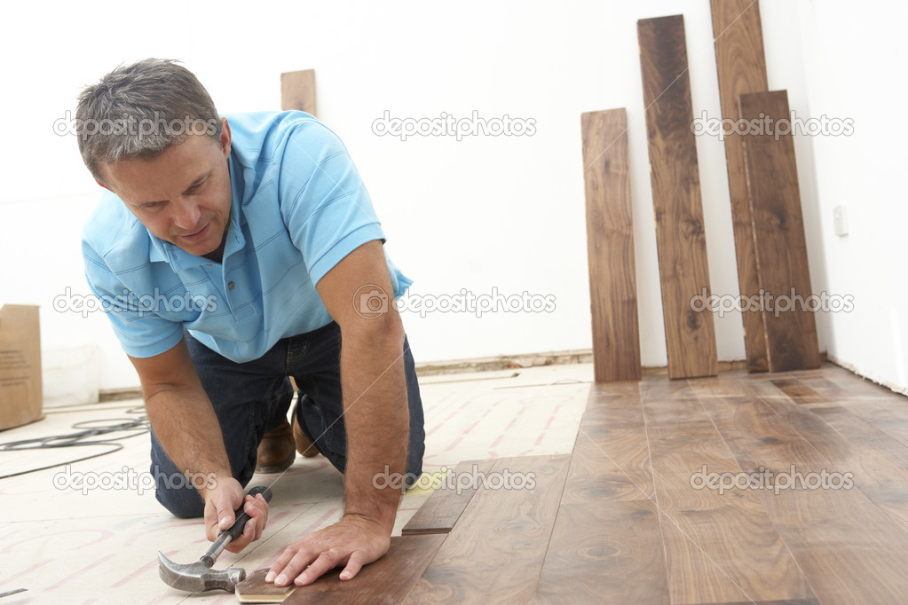 Builder Laying Wooden Flooring — Stock Photo #4824060