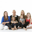 Shot Of Family Group Sitting In Studio — Stock Photo #4835416