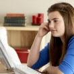 Teenage Girl Using Computer At Home — Stock Photo