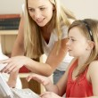 Mother And Daughter At Home Using Computer — Stock Photo