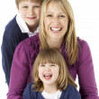 Mother With 2 Young Children In Studio — Stock Photo