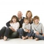 Studio Shot Of Family Group Sitting In Studio — Stock Photo