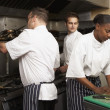 Team Of Chefs Preparing Food In Restaurant Kitchen — Stock Photo