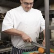 Male Chef Preparing Vegetables In Restaurant Kitchen — Photo