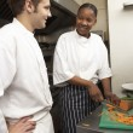 Chef Instructing Trainee In Restaurant Kitchen — Stock Photo #4835964