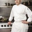 Male Chef Standing Next To Cooker In Restaurant Kitchen — Stock Photo #4835967