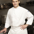 Male Chef Standing Next To Cooker In Restaurant Kitchen — Stock Photo #4835970