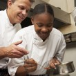 Chef Instructing Trainee In Restaurant Kitchen — Stock Photo