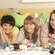 Stock Photo: Group Of Teenage Girls In Untidy Bedroom