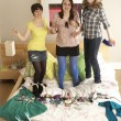 Group Of Teenage Girls Hanging Out In Untidy Bedroom - Stok fotoğraf