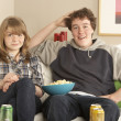 Teenage Couple Sitting On Sofa Watching TV — Stock Photo