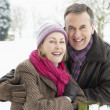 Senior Couple Standing Outside In Snowy Landscape — 图库照片