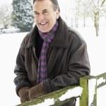 Senior Man Standing Outside In Snowy Landscape — Stock Photo #4836050