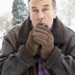 Senior Man Standing Outside In Snowy Landscape Warming Hands — Stock Photo