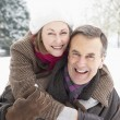 Senior Couple Standing Outside In Snowy Landscape — Stock Photo #4836072