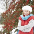 Senior Woman Standing Outside In Snowy Landscape - Lizenzfreies Foto