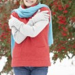 Stock Photo: Senior Woman Standing Outside In Snowy Landscape