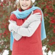 Senior Woman Standing Outside In Snowy Landscape - Stock Photo