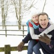 Senior Couple Standing Outside In Snowy Landscape — Photo