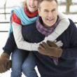 Senior Couple Standing Outside In Snowy Landscape - Lizenzfreies Foto