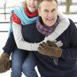 Senior Couple Standing Outside In Snowy Landscape - Стоковая фотография