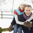 Senior Couple Standing Outside In Snowy Landscape — Foto de Stock