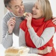 Stock Photo: Senior Couple Making Sandwich In Kitchen