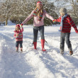 Mother Walking With Children Through Snowy Landscape — Stock Photo #4836146