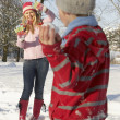 Stock Photo: Mother And Son Having Snowball Fight In Snowy Landscape