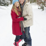 Couple Walking Through Snowy Woodland — Stock Photo