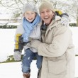 Father And Son Standing Outside In Snowy Landscape — Stock Photo #4836174