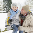 Father And Son Standing Outside In Snowy Landscape — Stock Photo #4836179