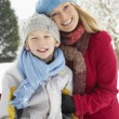 Mother And Son Standing Outside In Snowy Landscape — Stock Photo #4836184