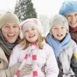 Family Sitting In Snowy Landscape — Stock Photo #4836190